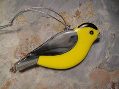 new birds added at black hill studios  Fused Glass Goldfinch Ornament - BHS02405. $24.00, via Etsy.