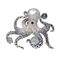 Octopus brooche in wight gold with perls, bleu sapphyrs, diamonds and aquamarines. (Apparently from a land of unorthodox English spelling.)