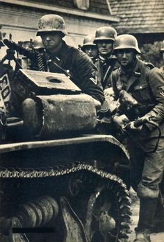 SS troop sets up MG on top of a French R35 tank (I think)  France 1940