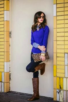Comfy over blue sweater with check shirt, long booties and leopard print clutch