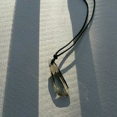"""Swarovski Crystal Necklace Swarovski cystral necklace is strung on a black cord with an adjustable length clasp. Crystal has grayish tones and of course, sparkles beautifully as all Swarovski crystals do. :) The chain is 16"""" long when worn on the last hoop of the chain clasp. Swarovski Jewelry Necklaces"""