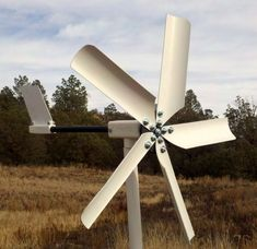 "Wind turbines. Enough to supply about 10.000 kWh or 10 MWh annually. ""We built a 1000 watt wind turbine to help charge the battery bank that powers our offgrid home. It's a permanent magnet alternator, generating 3 phase ac, rectified to dc, and fed to a charge controller. The magnets spin with the wind, the coils are fixed, so no brushes or slip rings necessary."" - MUCH cheaper. Just one foot. Designed to give to higher windspeeds, possibly by using a semi-flexible foot."