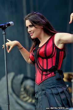 Sharon den Adel, beautiful and sexy metal singer performing in red and black bustier. Gorgeous and expressive. Chica Heavy Metal, Heavy Metal Girl, Symphonic Metal, Female Guitarist, Female Singers, Metal Sinfônico, Adele, Music Rock, Ladies Of Metal