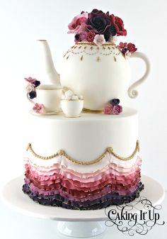 A stunning kitchen tea cake featuring bold and vibrant colours with hand piped gold detailing. Tea pot, tea cup and sugar bowl all handcrafted from fondant.  www.facebook.com/cakingitup