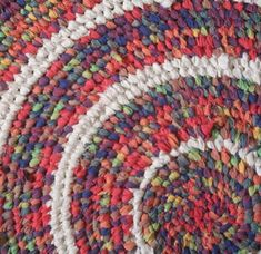 "Recycled Rainbow Toothbrush Rug, 30"" in diameter, by Karen Price. Sold for £30.00.  Made with discarded cotton fabric."