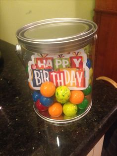 Gift for a paintball party.  Gum balls  and a gift card in a small clear paint can.