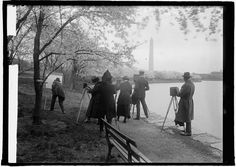 Crowd of people taking photographs of the cherry blossoms in 1922.  People looked so much classier then.