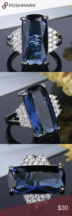 New white gold plated ring Beautiful brand new, never worn. Size 8 ring with white gold plating and a large 7 carat CZ deep blue stone with small CZ diamonds to accent. Jewelry Rings