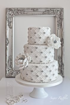 Elegant Silver Scalloped Wedding Cake by Sugar Ruffles. #weddingcake