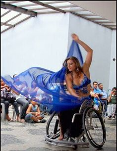 Wheelchair belly dancer! Since she has lost feelings of her legs (paraplegic t-9 and t-8)  she does not let that stop her while she puts on a performance in front of a crowd.