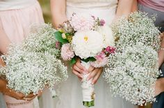 Baby's breath bridesmaids bouquets; Bridal bouquet of Dahlias and other seasonal blooms