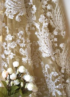 i love this sheer material with embroidery and lace. I love the floral patterns and this design would look lovely against bare skin. #TopshopPromQueen