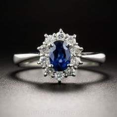 Sweet and petite. A rich royal blue oval faceted sapphire, weighing two-thirds-of-a-carat, fills a sparkling white diamond halo, all set in platinum. Just over 1/2 inch, currently ring size 5 1/4+.