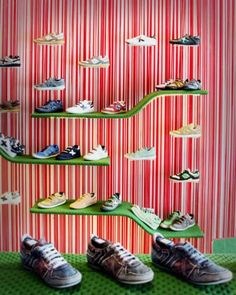 Dear Design have created this store for Munich footwear shoe store in Ireland. I admire the creative use of  shoelaces as main material in this store. They have covered the ceiling with hanging shoelaces and used it as a background surface to the walls.