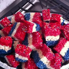 4th of July rice crispy treats. Thanks to pinterest!!  They look amazing and taste delicious.   I followed the basic recipe and when the marshmallows were melted I added in the color and layered them. I used Wilton Dab-N-Color. Worked great.