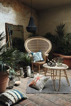 The Tribal Trend - rattan furniture, woven cushions and potted palms