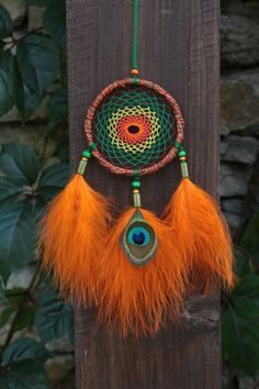 Handmade bright dreamcatcher. Car rear view mirror accesories.This dreamcatcher can an excellent decoration for your home also, and an excellent