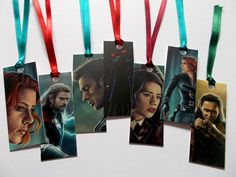 Mini bookmarks inspired by Marvels Avengers. Each bookmark features a design on one side and a ribbon in matching colours. Theyre printed on sturdy