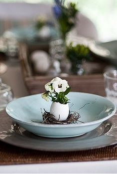 Simple yet effective table setting using an egg shell and Viola plant enhanced by the duck egg blue plate