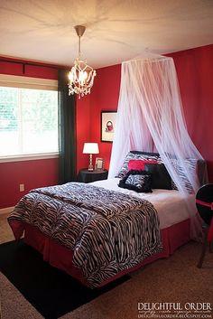 Fun teen room. Like the white sheer thing.