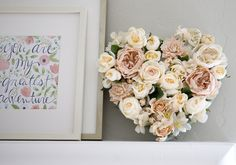 DIY Floral Heart - Could make any shape you have a stencil of. All you need is some faux flowers, florists foam (quite heavy duty available from Spotlight in Australia), desired stencil and a pair of good scissors! A beautiful touch that can be altered to suit the occasion! | 100 Layer Cake