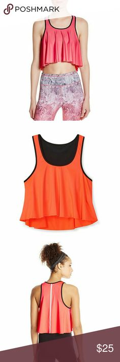NWT Rebecca Minkoff Tippi cropped sports bra top Strong is the new sexy, and this top is equal amounts of both. Fashionable, fun bra top is perfect for the gym or studio... It's even cute enough to be worn as a top. Comes with built in sports bra and a reflective strip up the back. Bright orange in technical, sweat-wicking fabric to keep you cool and dry. Rebecca Minkoff Tops Crop Tops