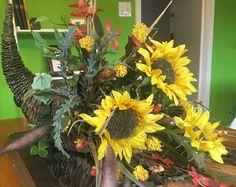 autumn splendor:  autumn, late summer, thanksgiving, cornucopia, floral design, sunflowers, yellow, orange, original art, centerpiece