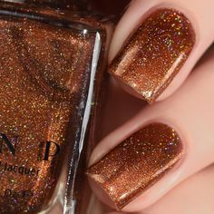Cabin Fever is a gorgeously beautiful burnt orange holographic nail polish with incredible complexity!  At first, you'll be awed by the deep, rusty burnt orange hues but take a closer look, and you'll notice the captivating shimmer of yellow gold, reddish-brown, and golden orange sparkles throughout!   Last but not least, Cabin Fever is also precisely accented with just the right amount of holographic sparkle that effortlessly brings everything together for a truly unique finish!   Fully…