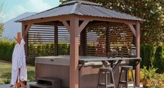 I would love to add a hot tub like this in my yard. It has a bar to put things. Also, it has the gazebo and that would be nice to keep rain or snow off of the hot tub. Hot Tub Pergola, Hot Tub Backyard, Hot Tub Garden, Garden Gazebo, Pergola Patio, Patio Bar, Pergola Ideas, Whirlpool Pergola, Outdoor Life