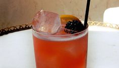 With a slug of spicy bourbon, this blackberry and bourbon cocktail isn't as demure as she looks.
