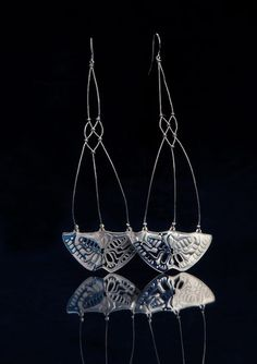 Bethamy Linton Earrings: Soldier series, 2012 Anodized titanium, sterling silver