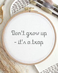 """A good reminder for all the kids in the world – """"don't grow up - it's a trap"""".😆 If I had the opportunity to go back in time I would never grow up again.🤫 En bra påminnelse för alla barn i världen - """"väx inte upp - det är en fälla"""".😆 Om jag hade möjlighet att gå tillbaka i tiden skulle jag aldrig växa upp igen.🤫 Embroidery For Beginners, Cross Stitch Designs, Diy Kits, Tool Design, Design Crafts, Wall Hangings, Design Your Own, Cross Stitch Embroidery, Barn"""