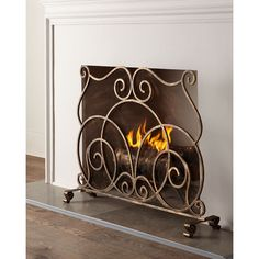 Lyrical Fireplace Screen ($480) ❤ liked on Polyvore featuring home, home decor, fireplace accessories, gold and handmade home decor