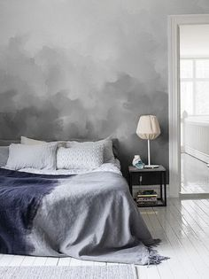 Why not go all the way? Ask a painter to create a wall with a cloud theme in shades of grey. Or buy wallpaper, like this beautiful, sophisticated one by Sandberg Wallpaper.