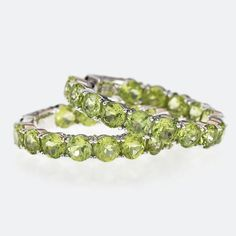 Tranquil and relaxing, these cool green peridot earrings are just what you need for your next island adventure! || 15.70ctw Round Peridot Inside-Outside Sterling Silver Hoop Earrings [Promotional Pin]
