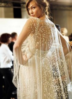 what a pretty idea for a wedding dress! Love the flowy airiness of the cape.