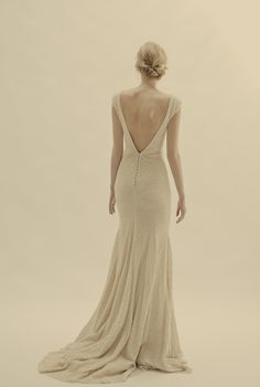 Magnolia   Fitted wool and silk crepe dress with boat neck and an open back.