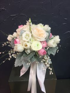 Beautiful Bridal bouquet with O'hara rose, white and soft pink ranunculus, white and soft pink tulips,white lisianthus, genista and silver leaves.