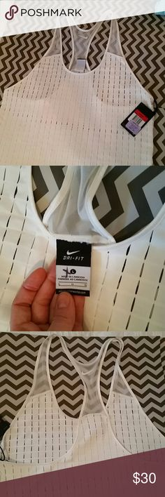White Nike tank top NWT New with tags, I paid 50 on sale it was originally $75. The fabric is phenomenal. It is a durable 100% polyester comfortable razor back tank. The underarms are lower so you can wear it with a colorful sports bra. It's an ivory white almost cream color. Nike Tops Tank Tops
