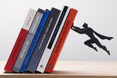 Superhero Bookends Keep Your Books Safely Elevated | Mental Floss. Need these for the husband's man cave!
