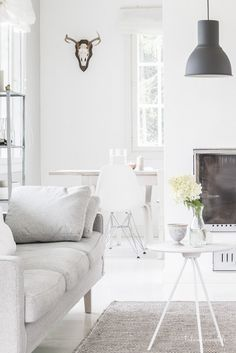 All whit interior with a white Key side table by One Nordic. Via Talosanomat.