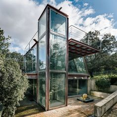 Glazed walls ensure the owners of this residence are presented with the best possible views of a picturesque forest outside Madrid.