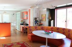 I'm loving orange lately, which is odd because I've never been a particular fan before. Also, that banquette rocks!