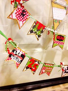 Christmas banner I made using @pickyourplum small wooden pennant banners.