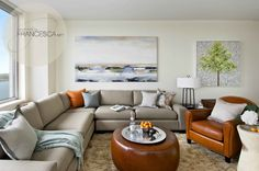 Cool, calm and collected living room, sectional sofa, coastal chic design, leather ottoman, nature inspired artwork, organic design