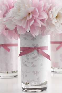 Easy DIY party centerpieces....pretty paper, drinking glass, ribbon, flowers