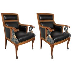 Pair of French Empire Bergeres Chairs with Swan Detailing and Gilt Accents | See more antique and modern Bergere Chairs at https://www.1stdibs.com/furniture/seating/bergere-chairs