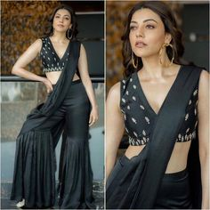 We're in awe of Kajal Aggarwal's bold fusion wardrobe. This black draped sharara paired with an edgy crop top is a smart pick for new-age bridesmaids. Pair the outfit with diamond danglers and silver stilettoes for a sparkling wedding look! Party Wear Indian Dresses, Dress Indian Style, Indian Wedding Outfits, Pakistani Dresses, Indian Outfits, Indian Wear, Wedding Dresses, Saree Trends, Stylish Sarees