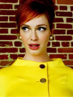 Let's all be honest and admit that Christina Hendricks could wear a paper bag and  it would work. >>> Loving the red with the yellow!