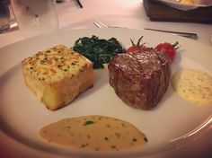 Dinner at the best steakhouse in Sydney with Steve and Samantha! Rare prime filet with blue cheese sauce and bernaise potatoes gratinee and spinach with hazelnuts. Yum! #steak #familydinner